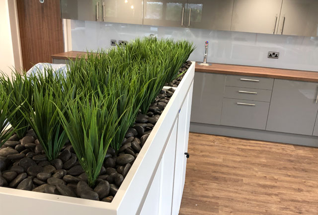 Artificial plant display for storage units