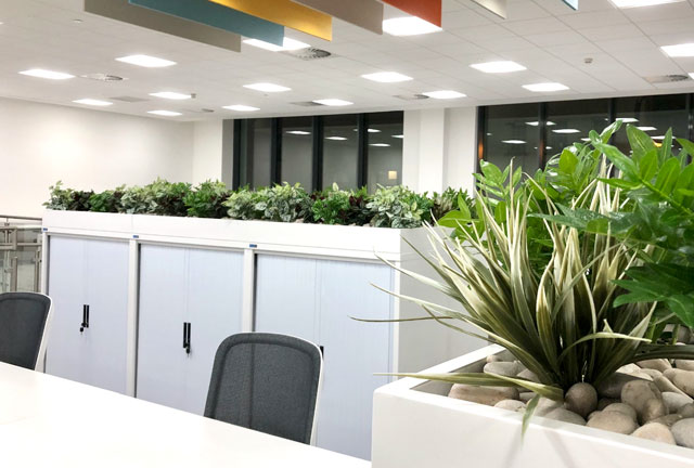 Artificial plant display for office tambour units
